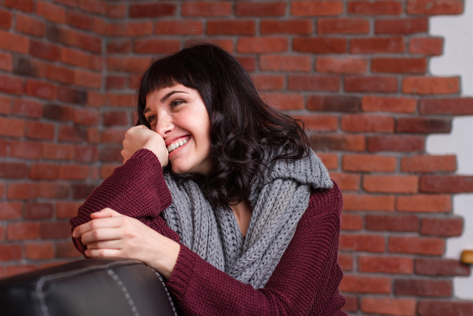 A woman getting shy and laughing.