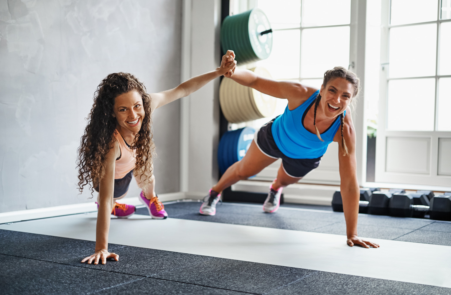 Two women exercising at the gym.